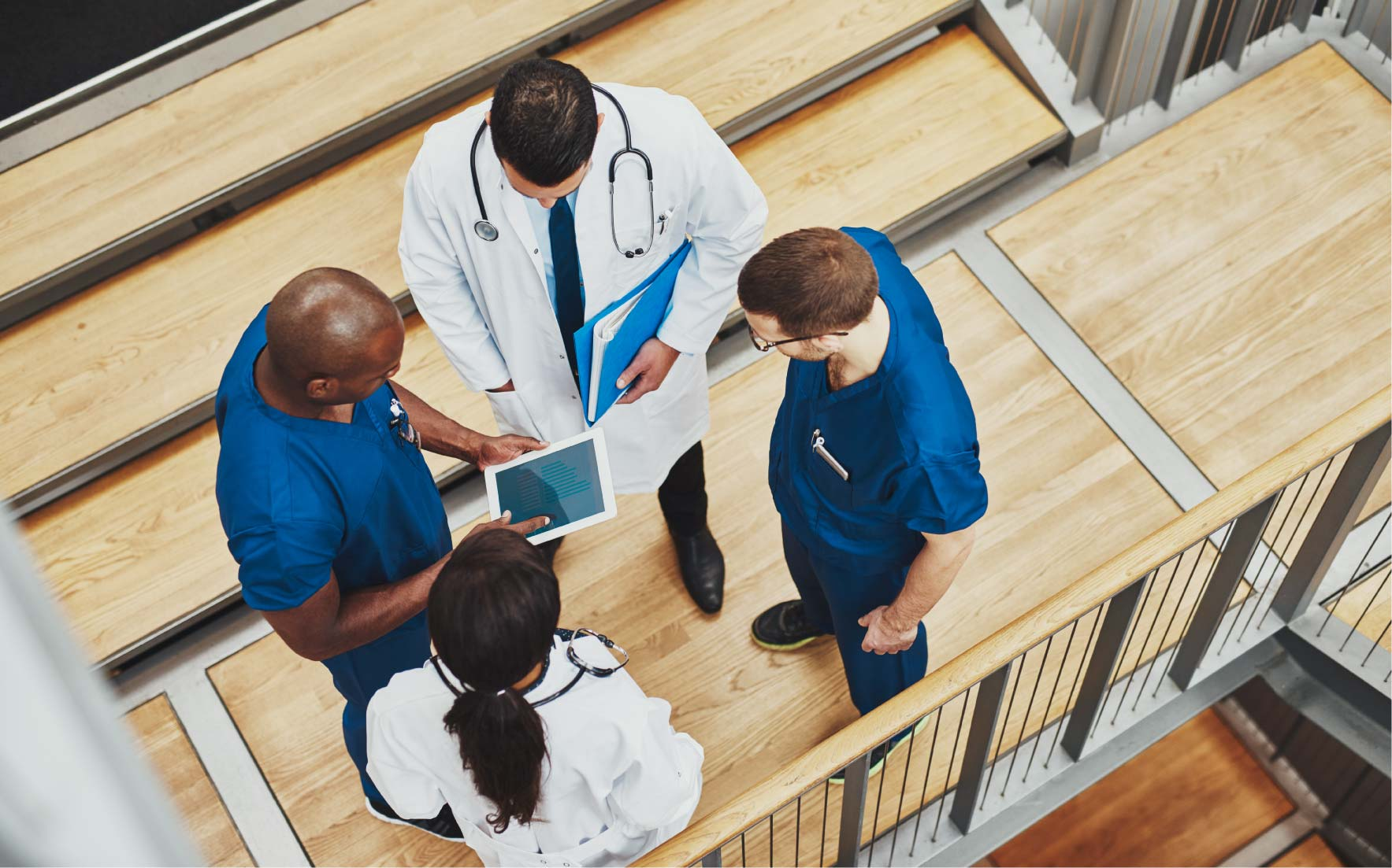 Group of medical professionals on staircase